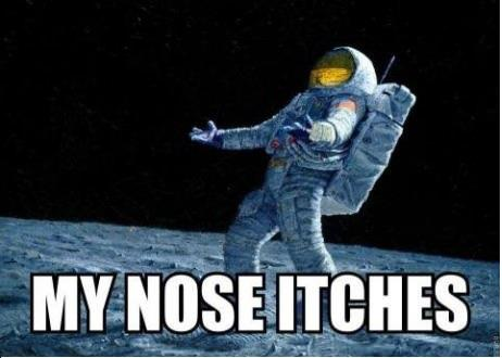 Armstrong's nose itches on moon : GAG